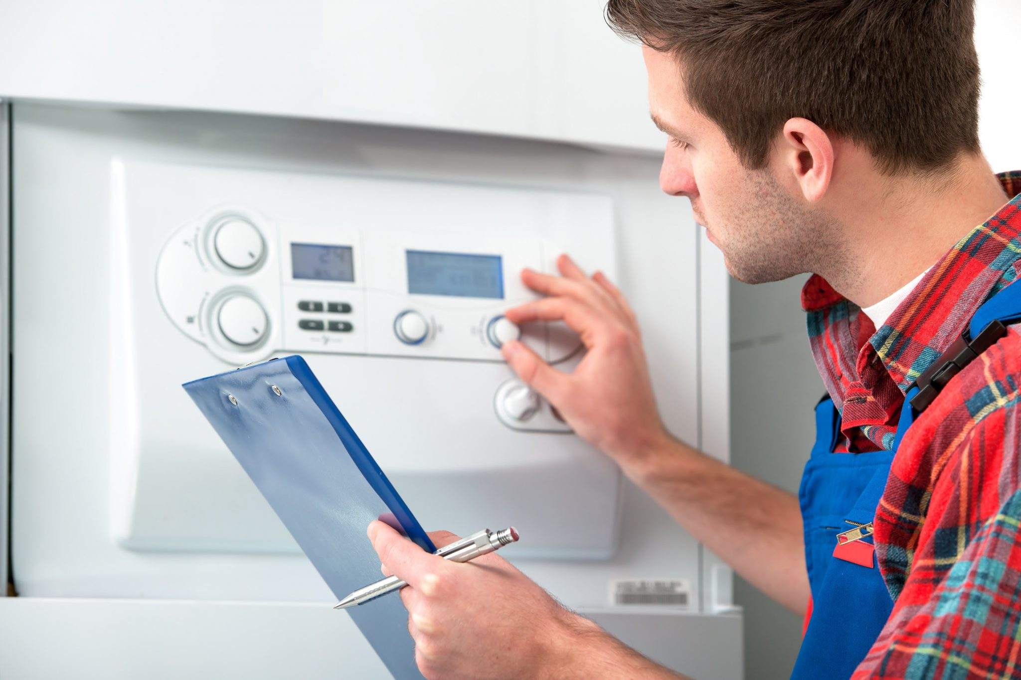 Technician Servicing Heating