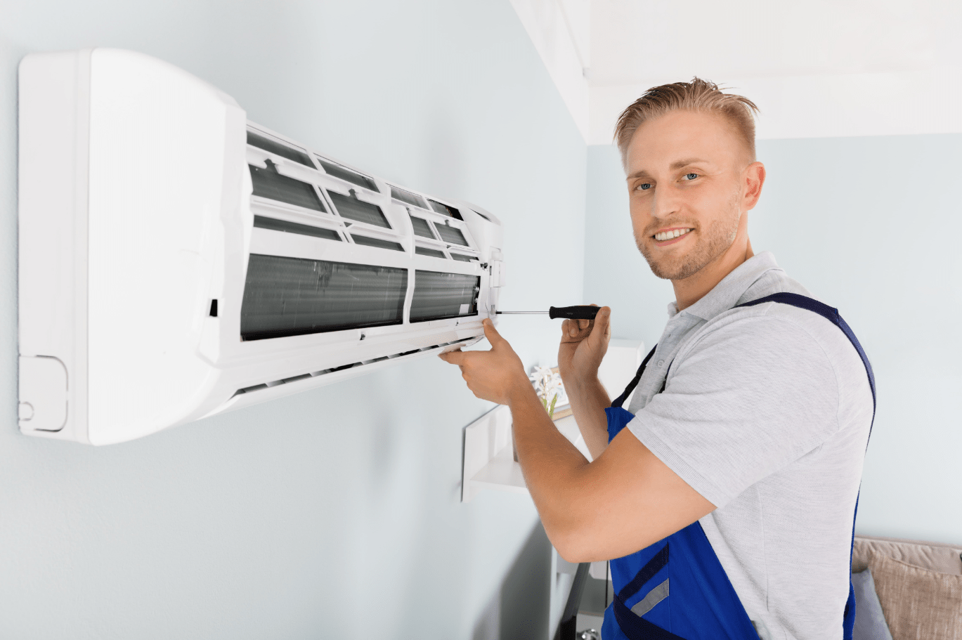 Young man working on Heat Pump